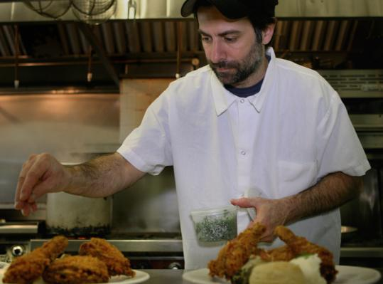 Mark Romano of Highland Kitchen in Somerville serves fried chicken with mashed potatoes, collard greens, and a biscuit.