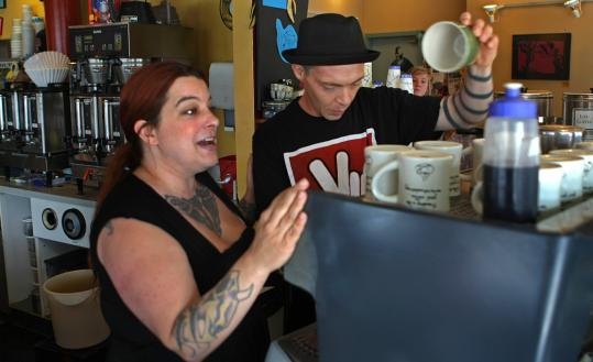 Page Masse (left) and her husband, Derek Brown, managers at the Allston Herrell's, said they have decided to leave the ice cream chain to preserve their shop's brash style.