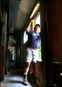 A worker, Bob Taggart, closes off a window on the second floor of the John Ball House, home to the Concord Art Association.