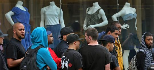 Customers in line outside Concepts shoe store in Harvard Square, waiting for their chance to buy a pair of Blue Lobster Nike sneakers (below).