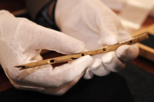 Archeologists displayed an ancient flute yesterday.