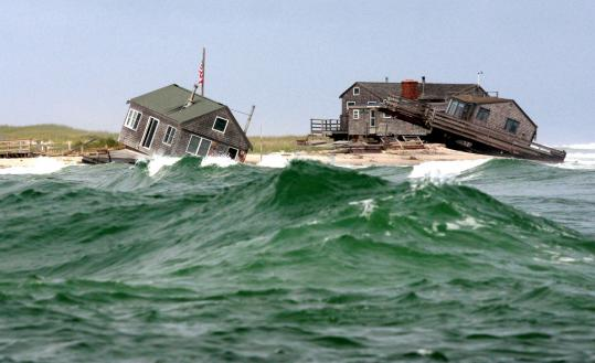 Two of five summer cottages on the southern tip of Nauset Beach in Chatham were knocked off their foundations by a storm this week. They will be demolished.