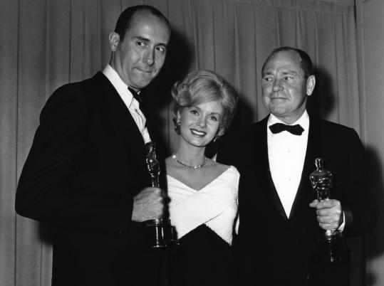 "Debbie Reynolds was the presenter in 1962 when Johnny Mercer (right) and Henry Mancini won Oscars for ""Moon River'' from ""Breakfast at Tiffany's.''"
