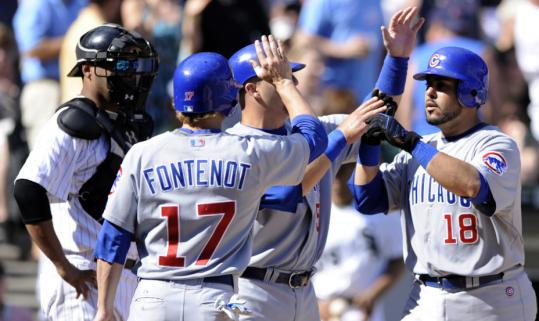 The Cubs&#8217; Geovany Soto (right) celebrates his three-run home run in the seventh inning that brought down the crosstown rival White Sox.