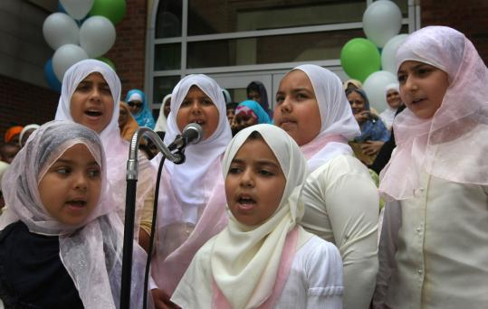 Children sang at the grand opening of the Islamic Society of Boston Cultural Center in Roxbury Crossing on Friday. The opening was attended by the mayor and a host of city religious leaders.
