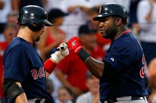 Jason Varitek (33) congratulates David Ortiz (34) of the Boston Red Sox after Ortiz's solo homer in the fifth inning.