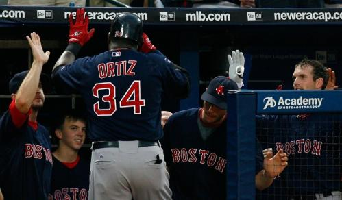 David Ortiz (34) of the Boston Red Sox celebrates his solo homer in the fifth inning against the Atlanta Braves.
