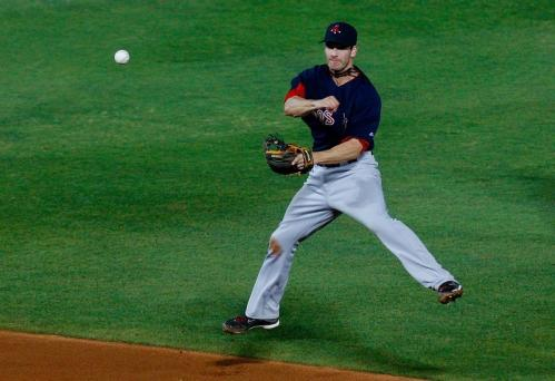 Red Sox shortstop Nick Green (22) leaps as he throws to first base.