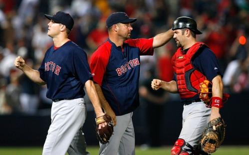 Manager Terry Francona congratulates pitcher Jonathan Papelbon (58) and catcher Jason Varitek (33) after a 4-1 win over the Atlanta Braves.