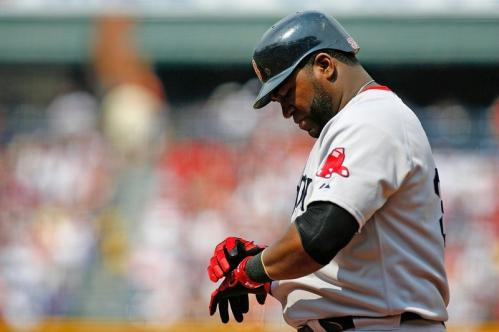 David Ortiz (34) of the Boston Red Sox adjusts his batting gloves against the Atlanta Braves.