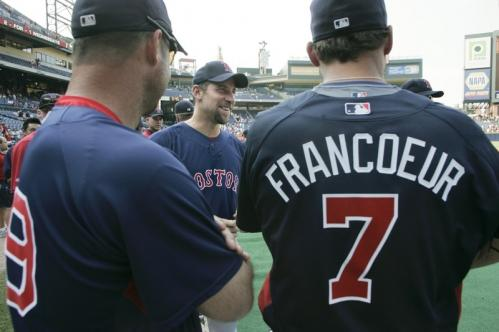 Boston Red Sox pitcher John Smoltz, center, talks with former Atlanta Braves teammate Jeff Francoeur, right, and coach Terry Pendleton, left, before the start of Friday's game.
