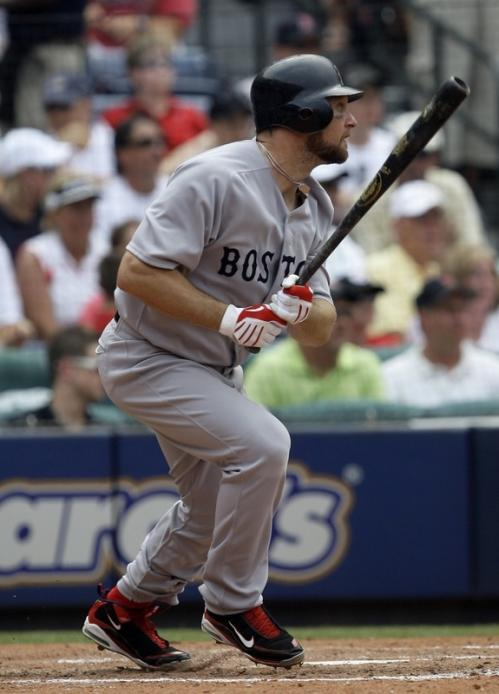 Boston's Mark Kotsay drives in the lone run of the game in the sixth inning.