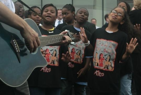Maria Baez, 11, far right, is part of the P.S. 22 Chorus, a group of fifth-graders featured in an online video.