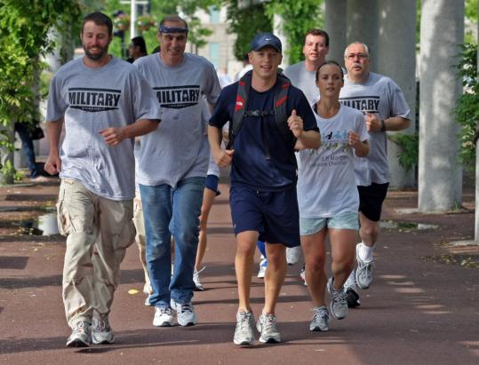Shannon Varney (third from left) ran last week with fiancee Robyn DesMarais and members of the veterans running club he started, which is opposed by New England Center for Homeless Veterans.