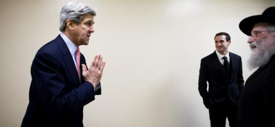 Senator John F. Kerry of Massachusetts greeted two men on his way to the Capitol in Washington, D.C.