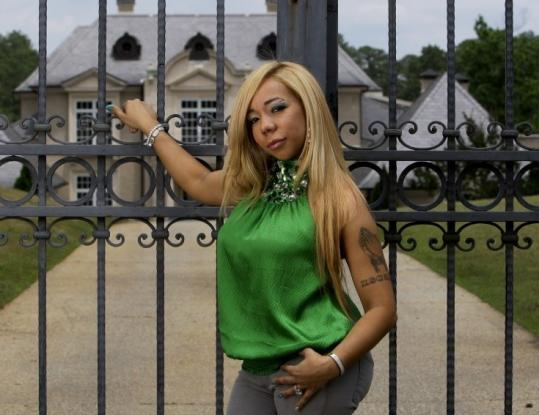"Tameka ""Tiny'' Cottle, fiancee to jailed rapper T.I., stars in a new BET reality show with her friend Antonia ""Toya'' Carter."
