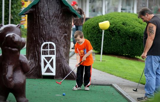 Zachary Quince and his dad, Gary, played a round at the Route 1 Miniature Golf & Batting Cages, which recently extended its coupon deal.