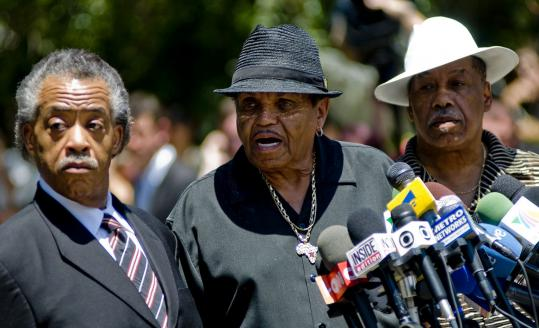 From left, the Rev. Al Sharpton, Joe Jackson, and Marshall Thompson at a press conference yesterday in Encino, Calif.