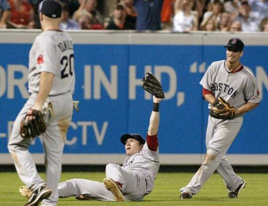 Jason Bay's nifty ninth-inning catch not only put the finishing touch on Boston's 4-0 win in Baltimore - it also impressed teammates Kevin Youkilis and Nick Green.