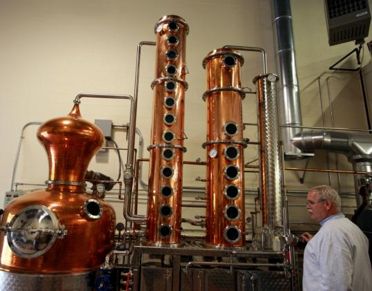 Still operator Jim Cook at Ryan & Wood distillery monitors the progress of one of the company&#8217;s products, believed to be the first produced in Gloucester since Prohibition.
