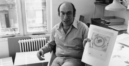 Milton Glaser, pictured in 1974 with one of his designs, in a scene from the documentary.