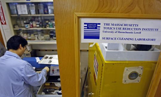 Research assistant Junhee Cho works at the Surface Cleaning Laboratory, part of the Toxic Use Reduction Institute in Lowell.