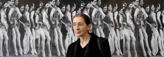 Standing in front of images of dancers, German choreographer Pina Bausch spoke at a press conference in Duesseldorf, Germany.