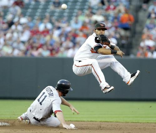Orioles shortstop Robert Andino (right) leaps over Red Sox base runner Mark Kotsay after forcing him out at second base in the second inning.