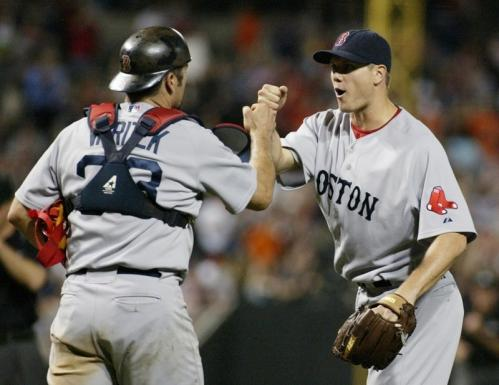 Red Sox closer Jonathan Papelbon is greeted by catcher Jason Varitek after the final out.