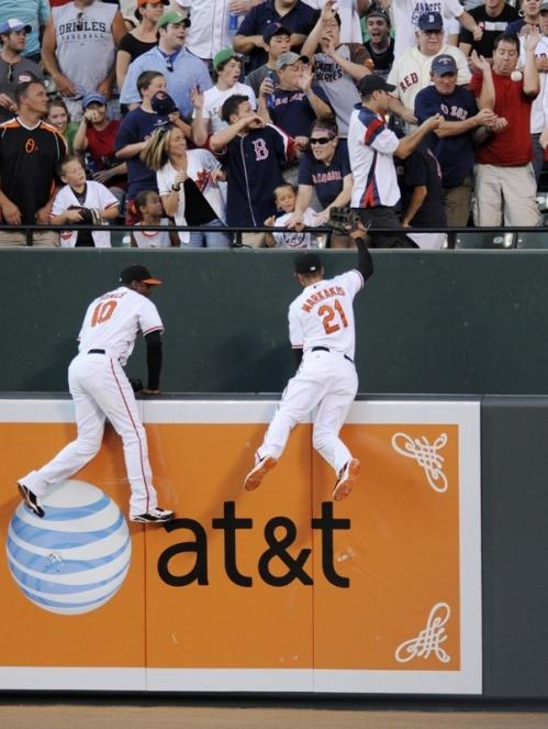JD Drew later atoned with a two-run home run that Orioles center fielder Adam Jones (10) and right fielder Nick Markakis (21) couldn't corral during the fourth inning.