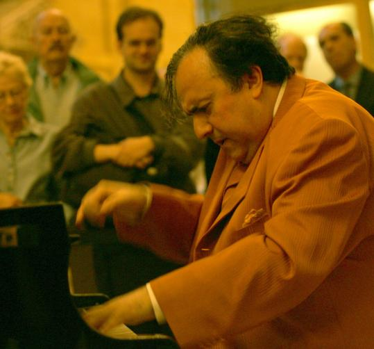 Pianist Yefim Bronfman (pictured playing at a benefit in New York's Grand Central Terminal) performs tonight at the opening of the BSO's Tanglewood season.