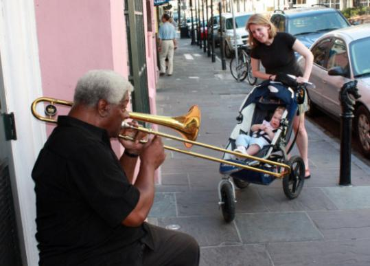 A street musician, one of the Big Easy's treats, gets the author and her daughter's attention.