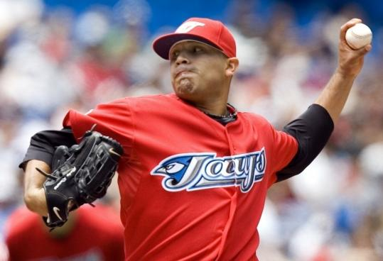 Blue Jays' Ricky Romero delivers to the Rays in the first inning yesterday; he went eight shutout innings and hasn't allowed a run in his last 20 frames.