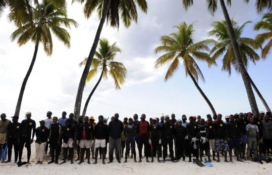 Divers waited by a temporary emergency camp set up in the north of the Comoros near the crash zone yesterday.