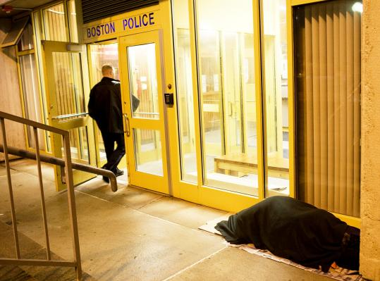 Diana slept in front of at the A-1 station on New Sudbury Street as police officers entered and left the building.