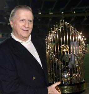 SAM MIRCOVICH/REUTERSYankees owner George Steinbrenner holds the 1998 World Series trophy after his team defeated the San Diego Padres.