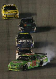 With a bump from Tony Stewart, Kyle Busch loses control before the finish.