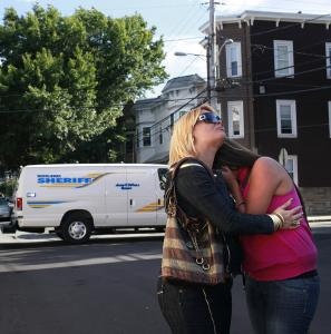 Maria Martell (left) consoled Katherine Avarado yesterday as they heard prisoners yelling from the Middlesex Jail in Cambridge. They said they had flown from Puerto Rico to visit a relative in jail but were not allowed to see him.