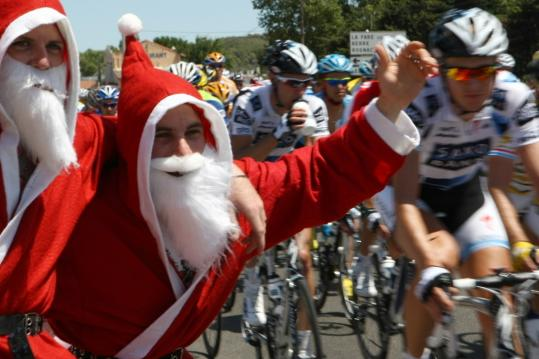 Christmas in July? No, just fans dressed as Father Christmas having a merry time at the Tour.