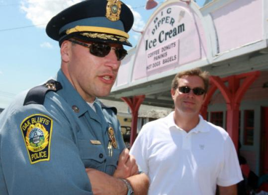 Police Chief Erik Blake of Oak Bluffs and administrator Michael Dutton see benefits in a presidential visit.
