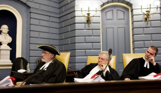 (From left) the Rev. Thomas Wintle, the Rev. Dudley Rose, and the Rev. Quinn Caldwell took part in the Massachusetts Bible Society's reenactment ceremony at the State House yesterday to mark its 200th anniversary of its founding.