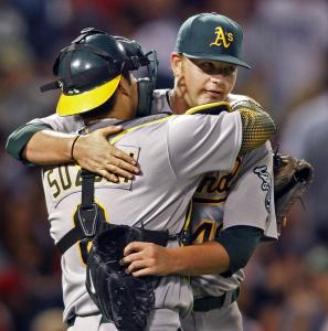 Brett Anderson was wrapped up by Kurt Suzuki after the A's lefthander allowed just two hits in his complete-game effort.