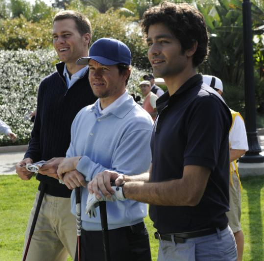 From left: Tom Brady, Mark Wahlberg, and Adrian Grenier on the set.