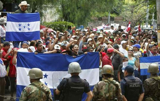 Supporters of Honduras's ousted president, Manuel Zelaya, protested in Tegucigalpa yesterday. Zelaya said he was pleased with the naming of Costa Rican President Oscar Arias as mediator.