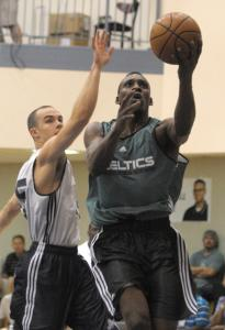 Celtics draft choice Lester Hudson drives past Utah's Jimmy Baron in an Orlando Summer Pro League game Monday.