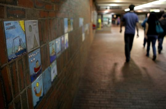 Many commuters walked by without pause at artwork created about 30 years ago by Somerville schoolchildren in the Davis Square MBTA station.