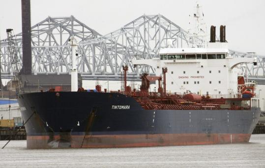 In July 2008, the bow of the tanker Tintomara was damaged in a collision with a tugboat at the Port of New Orleans. The man in the tug's wheelhouse, John Paul Bavaret II (right), held only an apprentice pilot's license. The fuel barge was sliced in half.