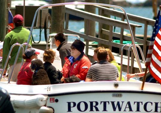 Senator Edward M. Kennedy and his wife, Vicki (center), headed out of the Hyannis Port Yacht Club for an afternoon of sailing Thursday. The ailing Kennedy has stayed involved in Congress's healthcare debate via telephone conference calls.