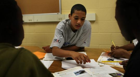 Marcelino Daveiga, 15, of Dorchester, tutors middle schoolers through a summer program run by Wheelock College to encourage more boys to consider teaching.