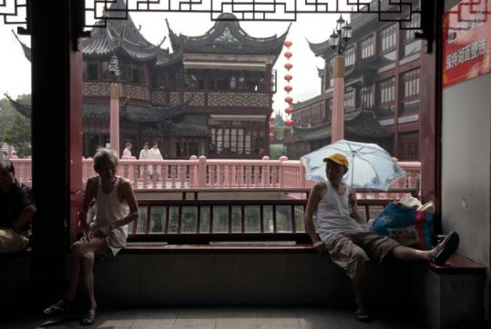 Elderly men sat on a bench at Yu Garden in Shanghai. The city provides a window into China's demographic future, as more than one-fifth of its population is at least 60 years old.